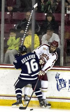 The action was not to every fan's liking as Tyler Kelleher checks Ian McCoshen into the boards in the first period.